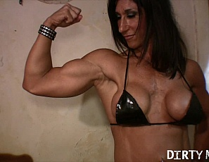 Tattooed female bodybuilder Hot Italian takes off everything but her tall boots, shows off her muscle control of her naked pecs and her muscular biceps, legs and abs in the bedroom, then penetrates herself with a toy and masturbates while you watch in close-up.
