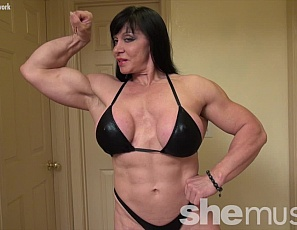 Female bodybuilder Ripped Princess is posing for you, showing off her ripped abs, big biceps, and muscular legs and glutes. Watch her muscle control of her pecs close-up.