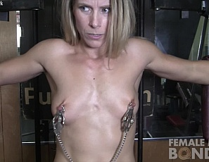 Female bodybuilder and muscle porn star Claire is chained up in the gym, wearing nipple clamps and moaning when the only place to sit is on a toy that's penetrating her pussy. even the mature muscles of her pecs, biceps, abs and legs don't help. Masturbation doesn't either. Watch her struggle in close-up.