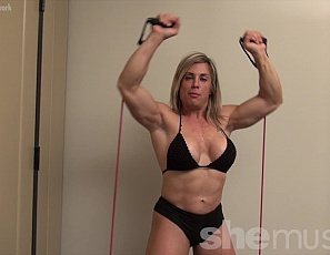 Watch as tattooed female bodybuilder Extreme Thule, in panties, works the mature muscles of her vascular biceps, pecs, calves, and legs, and poses to show off her ripped abs.
