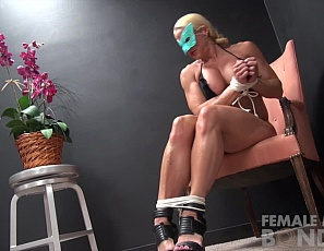 Female bodybuilder	Jill Jaxen is naked, masked and all tied up in her high-heeled shoes with her panties at her ankles, and she's taunting you as she uses the muscles of her powerful pecs, legs, vascular, tattooed biceps and ripped abs to free herself, posing for you when she succeeds so you can see it all close up.