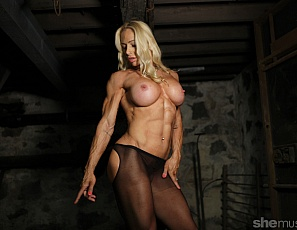 Professional female bodybuilder Jill Jaxen is in the dungeon, posing in sheer pantyhose with cutouts that show off her gorgeous glutes, and giving you a good look at the muscles of her vascular biceps, ripped abs, powerful pecs and legs and tattoos, as you take all the time you want to look at her in close-up.