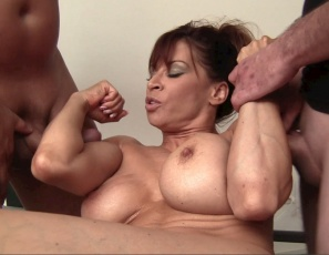 In her home gym, female muscle porn star Devon Michaels poses and gets her pecs, glutes, legs, biceps and abs muscles worshipped and her pussy and ass licked by her two men. She also gives a hand job, double bicep job, blow job and quad job.  Watch the muscle fucking and muscle sex in close-up while Devon doubles her pleasure.