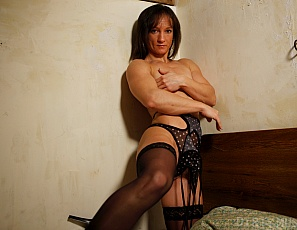 Sexy Vicky shows off in her bedroom wearing sexy high heeled shoes and silky stockings. She also shows off her lovely feet for those of you who appreciate the finer things. Combine that with Vicky's big biceps and powerful shoulder and back muscles and it makes for one amazing set of photos!