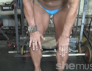 Professional female bodybuilder Annie Rivieccio works out in the gym, taking off her panties so she's naked, and posing to show you the muscles of her big, vascular biceps, ripped abs, and powerful pecs, and her muscle control.