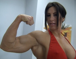 Female Bodybuilder and Muscle Porn star Angela Salvagno is naked, horny and trying to get her boyfriend interested by Posing for him, showing off the hard muscles of her Vascular Biceps, pecs, Legs, Glutes, and Abs. But all he wants to do is sleep – he won't even worship those massive muscles! So she humiliates him, scissors him, gives him CBT, then breaks out a toy to help solve the problem. What does she do with it? Stay tuned…