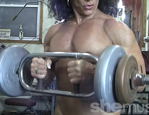 Professional female bodybuilder Annie Rivieccio is working her biceps and pecs in the gym, posing to show you how ripped and vascular her abs and legs are, and her muscle control.