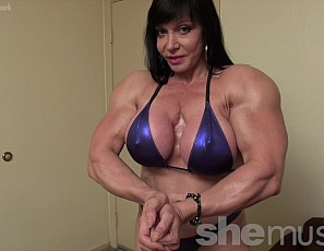 Female bodybuilder Ripped Princess is posing for you in a shiny blue bikini, showing off her ripped abs, powerful pecs, vascular biceps and legs, and her muscle control. Then she blows you a kiss. Blow back, won't you?