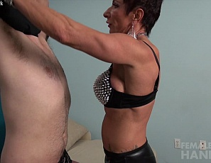 Female bodybuilder Anna Phoenixxx poses in high heels for a new client who needs hard-core training, belly-punching him with the strength of her mature biceps and ripped abs, and tattooed, vascular pecs and leg muscles, verbally humiliating him, and using her muscle control to insist on muscle worship and masturbation while you watch in close-up.