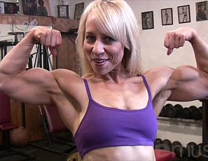 Powerful Genie works out in the Shemuscle gym and loves showing off her powerful biceps. She also likes displaying her fabulous glutes, strong legs, and pretty pecs. When Genie flexes we have no choice but to watch!