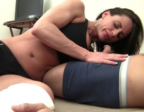 Fem domme and muscle porn star Nikki Jackson humiliates a one-time wrestler who's gone soft, scissoring him with her muscular legs and glutes, giving him CBT, punching his belly and insisting on muscle worship as she poses and flexes her biceps and pecs. Watch the fun in close-up.