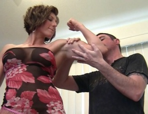 Female muscle porn star Mistress Amazon doesn't like the male hair and makeup artists she's been sent, so she humiliates and belly-punches them, then makes them worship her pecs, biceps, glutes, abs and leg muscles as she poses. They get hand jobs and biceps jobs, and you get to watch the group muscle sex and muscle fucking in close-up. Who needs makeup?