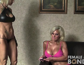 Female bodybuilder Megan Avalon can't use her phone. She has to obey her tattooed mistress Dani Andrews, who ties her up, makes her pose in panties, worships the muscles of her pecs, vascular biceps, legs, and ripped abs, and spanks her tight glutes while you watch in close-up.
