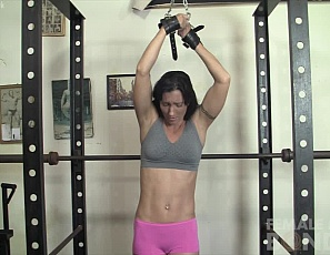 Wenona's chained up in the gym without her panties, and can't work her