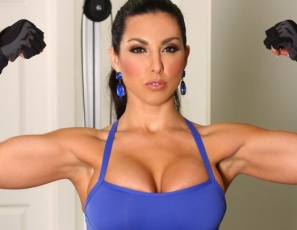 When you see Brianna Jordan working out her sexy pecs and big biceps and posing in the gym in a skin-tight outfit, you'd like to see more, and that's just what happens when she gets to the squat rack to tone her legs. Her stretchy pants fall down, and you get a nice look at her pretty kitty and naked behind. We'd call that booty-ful.
