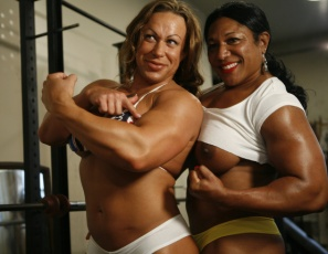Female bodybuilders, Carmella Cureton and MuscleFoxx are training in the gym, and with that much sexy ebony female muscle on display, it's not surprising that girl/girl muscle worship starts happening as they fondle each other's pecs, legs, glutes and biceps as they pose and pump.