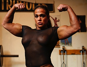 Female bodybuilder Dana is posing in the gym in a sheer bodysuit for you, showing off the mature muscles of her ripped abs, powerful pecs and biceps, and strong legs and glutes.