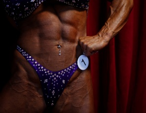 Competitive bodybuilder Debbie Bramwell does a private posing session for you. She's in competition shape, so you can see her spectacular biceps, triceps and lats; her dangerous abs; her outstanding vascularity - you're going to want to see every magnificently muscled inch. Which is why she's wearing #1.