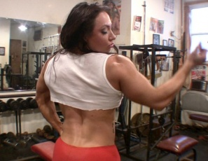 Female bodybuilder BrandiMae is naked and working her legs and glutes in the gym, doing hack squats while you look at her wet pussy, and posing to show you her vascular forearms and big biceps muscles, her ripped abs, and her powerful pecs. Watch in close-up as she masturbates her big clit until she cums.