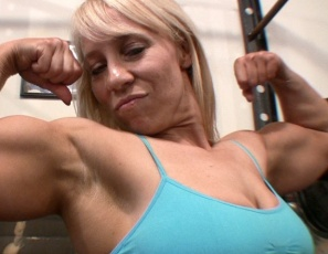Female bodybuilder Genie's in the gym, flexing her biceps, working her leg muscles and glutes, and posing for you, then taking off her panties to do squats. That gets her so hot she just has to masturbate. You get to watch in close-up.