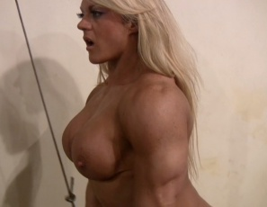 Female Bodybuilder Lisa Cross  is working out naked in the gym and posing to show you the massive, ripped, vascular muscles of her pecs, biceps, abs, legs and glutes. It gets her so hot that she bends over and starts masturbating and spanking her pussy. You get to watch in close-up.