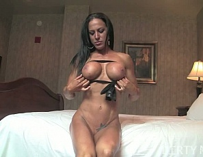 Rachel's naked in the bedroom, masturbating her pretty pussy and swollen clit and playing with her ass while you watch in extreme close-up and admire her muscles - her powerful pecs, her big biceps, her ripped, vascular, tattooed abs, and her strong legs and glutes.
