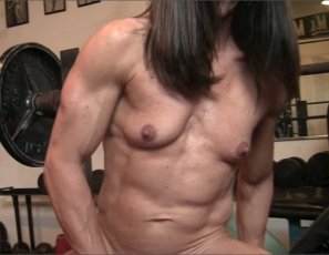 In the gym, a naked Tonya masturbates her big clit and penetrates herself with a big black dildo, as you enjoy her mature, muscular biceps, abs, legs and glutes and watch her wet pussy in close-up. Because when it rains… she pours.