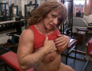 Female bodybuilder Wild Kat does bench presses in the gym, building the mature muscles of her pecs, biceps and abs. It gets her so wet, she just has to masturbate her wet pussy and big clit. You get to watch her pumped-up pussy in close-up.