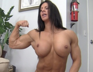 Ripped female bodybuilder Angela Salvagno gets muscle worship from her stepson, and gives him a calf job and foot job. After the muscle fucking, she poses for him, showing off her powerful pecs, vascular biceps, and strong abs, legs and glutes, and humiliating and smothering him and rubbing her big clit on his bald head while you watch in close-up. Add a bicep job and end with a cumshot and that's some wicked female muscle porn sex.