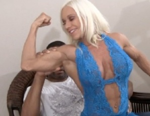 Female bodybuilder Ashlee Chambers is in charge of BBC programming today. The first show includes posing, muscle worship of Ashlee's big biceps, pecs, legs, glutes and calves, and masturbation, a hand job, a blow job, and muscle fucking with a calf job. Bet you didn't know the BBC offered female muscle porn sex and close-ups. Tune in soon for more.