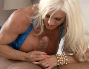 Female bodybuilder Ashlee Chambers is scissoring a man while she gives his BBC a quad job and calf job. After that muscle fucking, she smothers him with her pecs and gives him a hand job so he can look at her big biceps, then lets him worship her leg and glute muscles and allows him to masturbate on her. Watch the female muscle porn sex on the BBC in close-up.