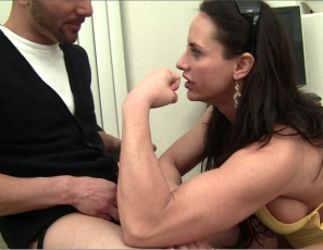 Fem domme and female muscle porn star Nikki Jackson is posing at home, showing off her strong pecs, legs and biceps. She's happy to see her visitor wearing a purple strap-on toy, but not happy to find out that he didn't bring  her chocolates. So she lifts and carries him, humiliates him and makes him masturbate for her and worship her big muscles. She's one dirty domme.