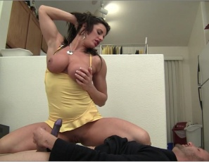 Female bodybuilder and fem domme Nikki Jackson is belly punching her boy toy humiliating him, and giving him some CBT, then smothering him with her powerful pecs, biceps and legs and making him worship her muscles and wear a strap-on to penetrate her. It's some dirty muscle porn.