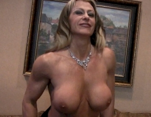 Mature female bodybuilder Gina Jones is posing for you in the bedroom, showing you how ripped and vascular she is, and pointing out all her hard muscles: her wide lats, her big pecs and biceps, her strong legs and glutes and her awesome abs. Now that you've met her, you won't forget her.