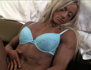 Female bodybuilder Katka Kyptova is posing for you in pale blue lingerie and high-heeled shoes, showing off her powerful pecs, her big, vascular biceps, her ripped abs, her muscular legs, glutes and calves and her muscle control. You'll like watching her play with her pale blue panties.