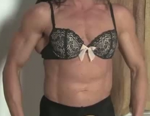 In the bedroom, female bodybuilder Tonya poses for you, showing you how ripped the mature muscles of her pecs, biceps, abs and legs are. But she's not just cut, she's cut out – take a look at her pretty pussy in crotchless pantyhose as she rubs her clit.