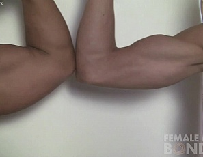 Female bodybuilder Genie and her new tattooed friend compare biceps and leg muscles, pose, and lift and carry each other. Then Genie gets tied up over her stockings, and gets her pecs and ass spanked.
