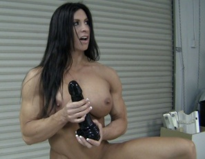 Ripped, vascular female bodybuilder Angela Salvagno is testing out her new gigantic dildo and riding up and down on the toy as she masturbates her big clit. Watch it penetrate her wet pussy in close-up and enjoy looking at her muscular pecs, legs,  calves, biceps,  abs and glutes.  After testing, she says it's the best tool ever.