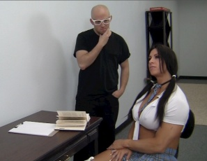 Female Bodybuilder Angela Salvagno is one schoolgirl who isn't taking detention lightly.  That's why she's humiliating, smothering, scissoring and belly-punching her teacher, giving him CBT, insisting on muscle worship, and posing naked to show off her huge, vascular biceps, her ripped abs, and her powerful pecs, legs, glutes and calves. The moral of the story: don't detain a femme domme.