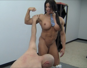 Female bodybuilder Angela Salvagno humiliates and dominates her teacher, belly-punching him, scissoring him with her powerful legs and glutes, smothering him with her pecs, making him worship her big, vascular biceps and calf muscles and ripped abs while she poses, and getting off by rubbing her big clit against his bald head. If you're majoring in female muscle porn, study this.