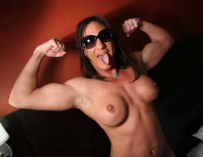 Bodybuilder Italian Muscle keeps her dark glasses on as she poses nude for you in the bedroom, licking her own biceps and masturbating, giving you a close-up look at her big clit and showing off her sexy pecs, legs and glutes.  She's so hot, she's gotta wear shades!