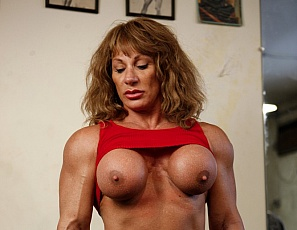 In the SheMuscle Gym, bodybuilder Wild Kat works out and poses nude. You'll love how muscular her biceps, quads and calves are and how good her glutes, pecs and abs look, but what you might like best of all is the look of Kat's big clit.  It appears that she's giving that a good workout too. Care to join her?