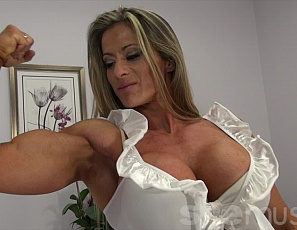 When a professional female bodybuilder invites you into her bedroom, you know she has something special in mind, like posing for you in sexy panties and high heels, and showing you her ripped abs, powerful pecs, vascular biceps, muscular legs and glutes, and her tattoo.