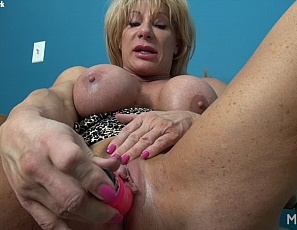Female bodybuilder Wild Kat loves masturbating her big clit with a vibrator, pushing the toy all the way into her pussy and making her clit even bigger, while you watch in close-up and enjoy looking at the ripped, mature muscles of her vascular biceps, pecs and legs.