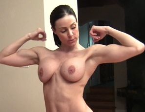 Enjoy a close-up look as female muscle porn star Kendra Lust makes one man her human carpet and poses for muscle worship from the other, showing off her powerful biceps, pecs, legs, glutes and abs and her muscle control, and giving a hand job and CBT to keep the group lust going.