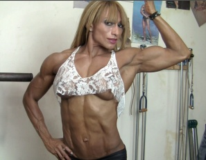 Wearing a lacy top and tiny black panties, professional female bodybuilder Karina does barbell rows in the gym and poses to show you the incredible muscles of her vascular, ripped biceps,  pecs, abs, legs, glutes and calves. Quite the belle, isn't she?