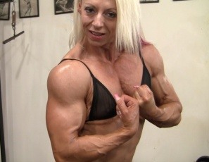 Professional female bodybuilder Nathalie Falk is posing in thong panties in the gym, showing you her muscular, vascular pecs, biceps, legs and glutes and her ripped, tattooed abs.