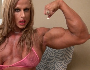 Female bodybuilder Nuriye is a true-life amazon. In your virtual session, she's posing in high-heeled shoes and fishnet panties and showing you how vascular and muscular her biceps, legs, and calves are, how ripped her abs are and her muscle control of her pecs.