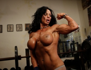 Ever seen a female bodybuilder in fishnet tights in the gym before? Or a woman with one hand on a barbell and the other on her kitty? Then you haven't been in the gym with Rhonda Lee Quaresma, who gets naked and poses to show off her impressive pecs and glutes in these photos, and who is well-developed everywhere.