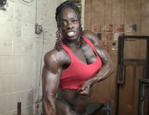 In the gym, Female Bodybuilder Roxanne Edwards poses for you, showing you how Ripped and Vascular her Ebony Abs are, and demonstrates how she trains the massive Muscles of her Pecs, Legs, Glutes, Calves and Biceps.